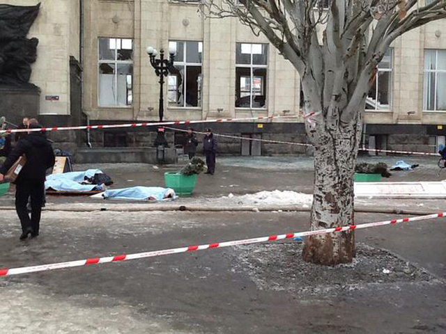 In this photo taken on a cell phone,  made available by Volgograd Mayor's Office, bodies lie at an entrance to Volgograd railway station, Sunday, Dec. 29, 2013. More then a dozen people were kille ...
