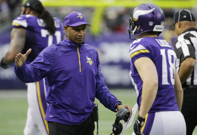 Minnesota Vikings head coach Leslie Frazier, left, reacts with punter Jeff Locke during the first half of an NFL football game against the Detroit Lions, Sunday, Dec. 29, 2013, in Minneapolis. The ...