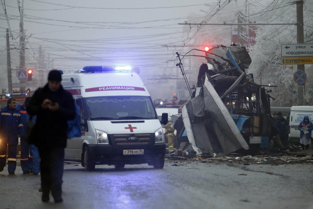 An ambulance leaves the site of a trolleybus explosion in Volgograd, Russia on Monday. The explosion left 14people dead, a day after a suicide bombing that killed at least 17 at the city's main ra ...