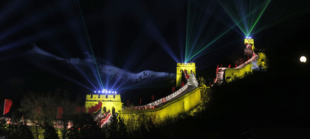 Laser lights shoot from towers during a New Year's Eve count down to 2014 held at the Great Wall of China in Beijing on Tuesday. (AP Photo/Ng Han Guan)