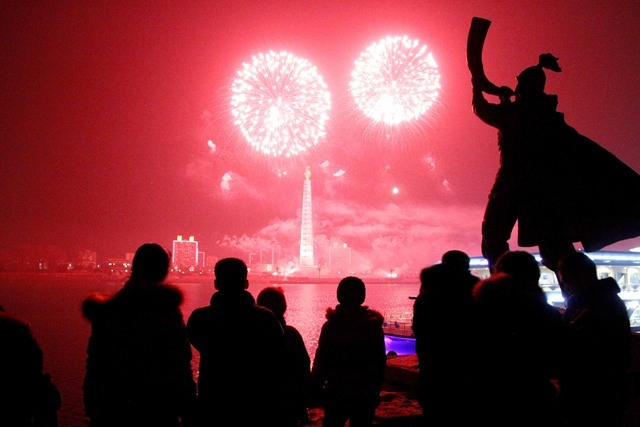 Fireworks explode over Juche Tower and the Taedong River in Pyongyang, North Korea, to celebrate the New Year on Wednesday. (AP Photo/Kim Kwang Hyon)