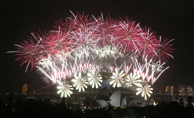 Fireworks explode over the Harbour Bridge and the Opera House during New Year's Eve celebrations in Sydney, Australia, on Wednesday. (AP Photo/Rob Griffith)