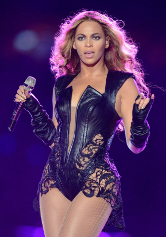 FILE - In this Feb. 3, 2013 file photo, recording artist Beyonce performs at Super Bowl XLVII, in New Orleans. Beyonce stopped short of apologizing for using a sample of audio from the Space Shutt ...