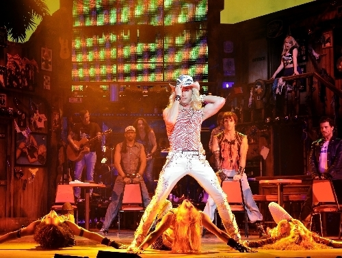 "Kyle Lowder, as Stacee Jaxx, center, rehearses with the rest of the cast on the set of ""Rock of Ages"" at The Venetian. (Review-Journal/File)"