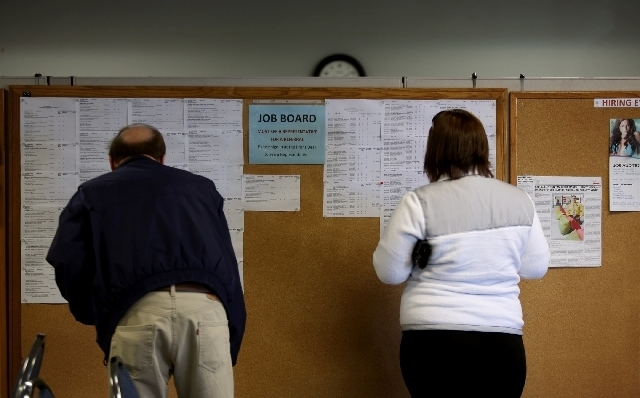 People look at the employment board at Nevada JobConnect in Henderson. (Review-Journal File Photo)