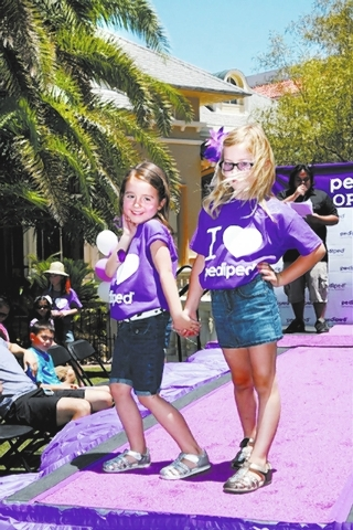 Ainsley, left, and Elizabeth, both 5, walk the runway in a June 1 fashion show launching the opening of pediped footwear in Town Square. The children's footwear brand opened a second store in Sh ...