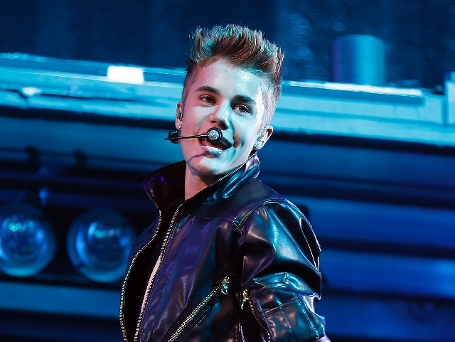 Justin Bieber performs at the MGM Grand Garden on Sept. 30. Media reports indicate that Bieber and his entourage didn''t live up to an agreement with Vegas Indoor Skydiving, failing to post a pho ...