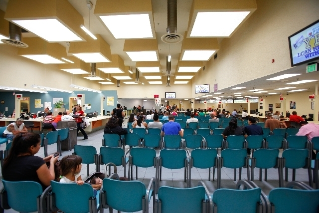 People sit in the waiting area for their numbers to be called at the DMV office at 2701 E. Sahara Ave. (Las Vegas Review-Journal/File)