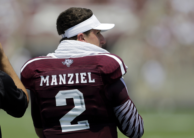 Texas A&M's Johnny Manziel watches from the sidelines during the second quarter of a game against Rice on August 31. (AP Photo/Eric Gay)