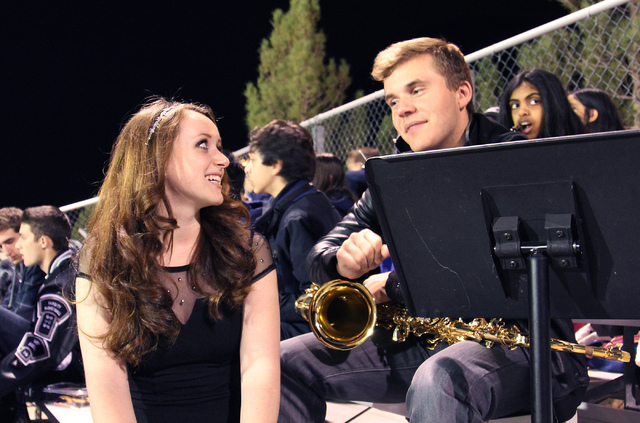 Meadows student Alexis Ross, left, discusses the football game with fellow student and saxophonist for the Meadows School Pep Band Austin Fenner during their game against Needles in Las Vegas on N ...