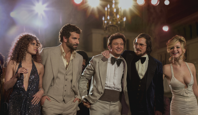 (l to r) Amy Adams, Bradley Cooper, Jeremy Renner, Christian Bale and Jennifer Lawrence in Columbia Pictures' AMERICAN HUSTLE.