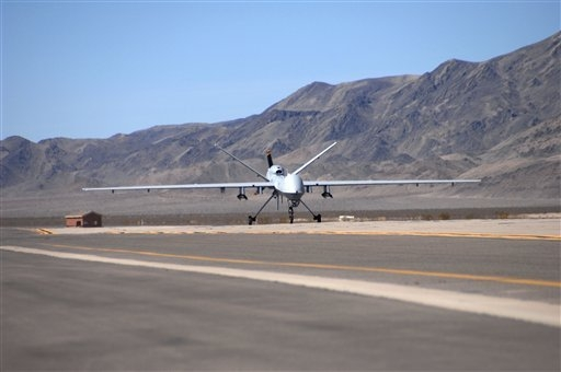 In this photo released by the Department of Defense, an MQ-9 Reaper unmanned aerial vehicle from the 42nd Attack Squadron taxis into Creech Air Force Base, Nev., March 13, 2007.  (AP Photo/U.S. Ai ...