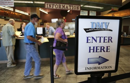 Las Vegas and Henderson residents enter the Department of Motor Vehicles to renew vehicle registration and drivers licenses in this file photo. (AP Photo/Julie Jacobson)