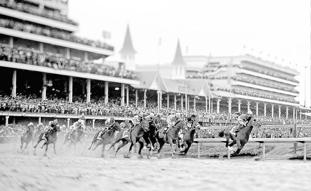 Horses make their way around turn one during the 139th Kentucky Derby at Churchill Downs on May 4 in Louisville, Ky. (AP Photo/Matt Slocum)