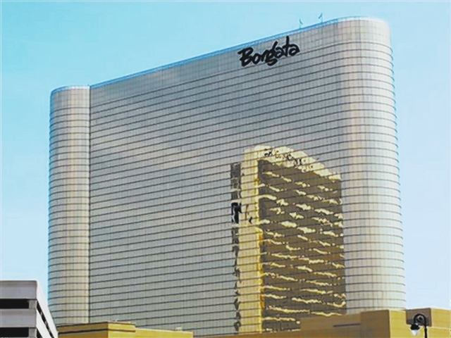 In this June 26, 2013 photo, the Borgata Hotel Casino & Spa is seen in Atlantic City, N.J., with the nearby Water Club reflected in its gold glass facade. The casino's third quarter revenue rose b ...