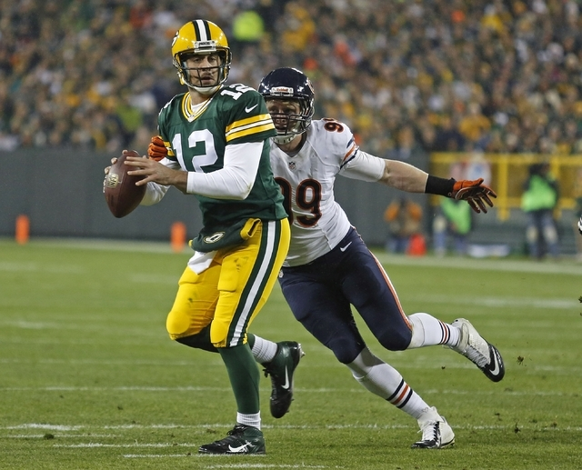 Green Bay Packers quarterback Aaron Rodgers gets sacked by Chicago Bears defensive end Shea McClellin during an NFL football game Monday, Nov. 4, 2013, in Green Bay, Wis. (AP Photo/Matt Ludtke)