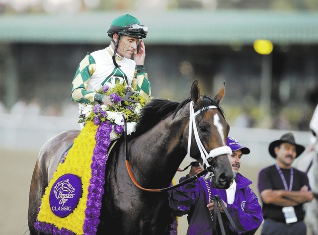 Jockey Gary Stevens, shown aboard Mucho Macho Man after winning the Breeders' Cup Classic on Nov. 2, will be at the South Point race book Wednesday for a meet and greet. (AP Photo/Gregory Bull)