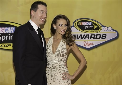 Kyle Busch and wife Samantha arrive Friday at Wynn Las Vegas for the NASCAR Sprint Cup Series awards ceremony, the final NASCAR Champion's Week event. (AP Photo/Eric Jamison)