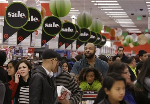 People shop at a Target store in Colma, Calif., Thursday, Nov. 28, 2013. Instead of waiting for Black Friday, which is typically the year's biggest shopping day, more than a dozen major retailers  ...