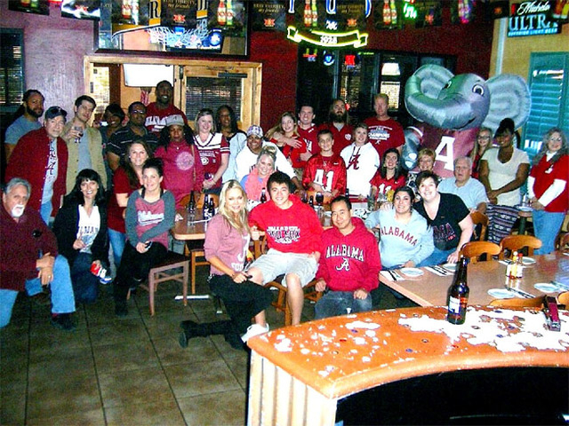 Alabama fans pose during a viewing party for the Crimson Tide's game against Auburn on Saturday. Top-ranked Alabama lost to the rival Tigers on a missed field-goal return. (Courtesy)