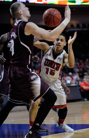 UNLV's Kendall Smith (15) and Mississippi State's Colin Borchert vie fora loose ball during the first half of an NCAA college basketball game at the Las Vegas Classic at the Orleans Arena on Monda ...