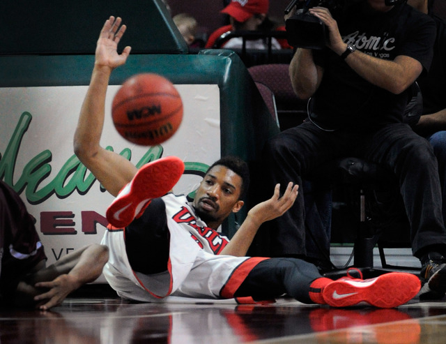 UNLV's Khem Birch (2) collapses to the ground as he attempted to rebound the ball against Mississippi State during the first half of an NCAA college basketball game at the Las Vegas Classic at the ...