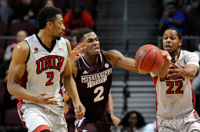 UNLV's Khem Birch (2) and Jelan Kendrick (22) and Mississippi State's Dre Applewhite go for the ball during the first half of an NCAA college basketball game at the Las Vegas Classic at the Orlean ...