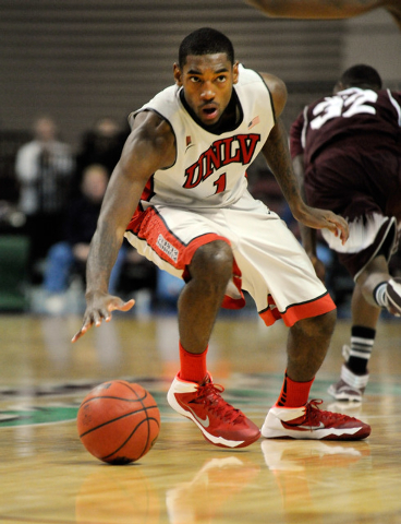 UNLV's Roscoe Smith (1) looks on as he brings the ball up court against Mississippi State during the second half of an NCAA college basketball game at the Las Vegas Classic at the Orleans Arena on ...