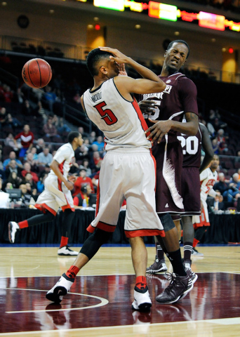 UNLV's Christian Wood (5) and Mississippi State's Roquez Johnson (25) react after the two collided during the second half of an NCAA college basketball game at the Las Vegas Classic at the Orleans ...