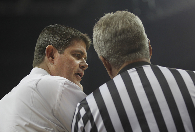 UNLV head coach Dave Rice talks to the referee while taking on Radford at the Thomas & Mack Center in Las Vegas on Dec. 18, 2013. (Jason Bean/Las Vegas Review-Journal)