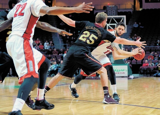 UNLV senior forward Carlos Lopez-Sosa, right, tries to thread a pass around Santa Clara's John McArthur during the Rebels' 92-71 victory in the Las Vegas Classic on Sunday at Orleans Arena. (D ...