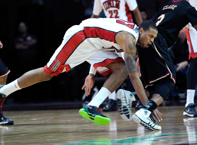 UNLV's Bryce Dejean-Jones (13) runs into the back side of Santa Clara's Brandon Clark during the first half of an NCAA college basketball game at the Las Vegas Classic at the Orleans Arena on Sund ...
