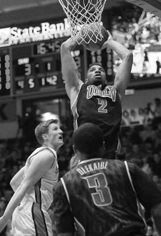 UNLV's Khem Birch (2) dunks over Southern Utah's A.J. Hess (35) during their basketball game at Centrum Arena in Cedar City, Utah on Dec. 14, 2013. (Jason Bean/Las Vegas Review-Journal)
