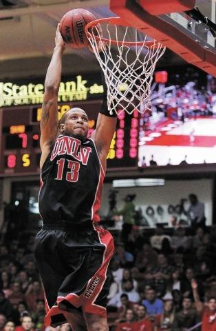 UNLV's Bryce Dejean-Jones (13) dunks against Southern Utah during their basketball game at Centrum Arena in Cedar City, Utah on Dec. 14, 2013. (Jason Bean/Las Vegas Review-Journal)