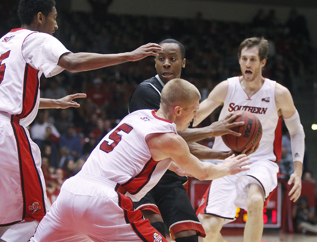 UNLV's Kevin Olekaibe (3) looks to pass while being guarded by Southern Utah's John Marshall (5) during their basketball game at Centrum Arena in Cedar City, Utah on Dec. 14, 2013. (Jason Bean/Las ...