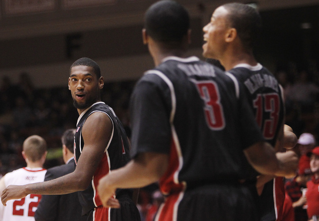 UNLV's Roscoe Smith, left, laughs with teammates Kevin Olekaibe (3) and Bryce Dejean-Jones (13) after defeating  Southern Utah at Centrum Arena in Cedar City, Utah on Dec. 14, 2013. (Jason Bean/La ...