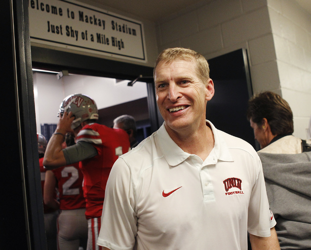 UNLV head coach Bobby Hauck is all smiles after defeating UNR at Mackay Stadium in Reno on Oct. 26, 2013. (Jason Bean/Las Vegas Review-Journal)
