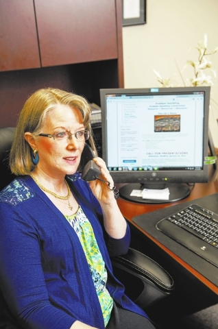 Carol O'Hare, executive director of the Nevada Council on Problem Gambling, works in her office in Las Vegas on Dec. 12. Nevada Council on Problem Gambling offers a variety of services for people  ...