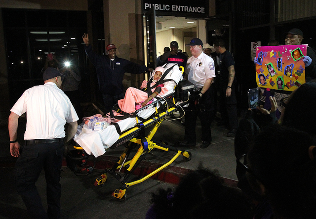 Six-year-old Brazyl Ward is taken from University Medical Center Childrenճ Hospital of Nevada to a waiting ambulance for transportation to a rehabilitation hospital Thursday, Dec. 26, 2013.  ...