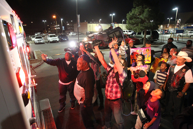 Family, friends and the news media watch as 6-year-old Brazyl Ward is taken from University Medical Center Childrenճ Hospital of Nevada to a rehabilitation hospital Thursday, Dec. 26, 2013.  ...