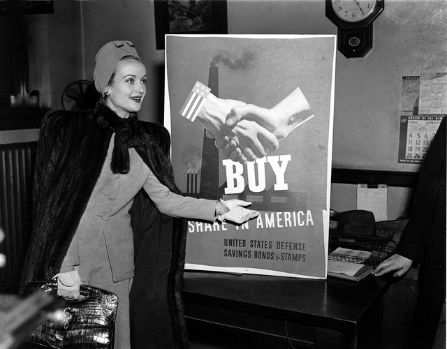 Actress Carole Lombard is seen rehearsing her role in selling defense bonds and stamps on Jan. 14, 1942, in Chicago. Lombard died in a plane crash on Mount Potosi, southwest of Las Vegas, on Jan.  ...