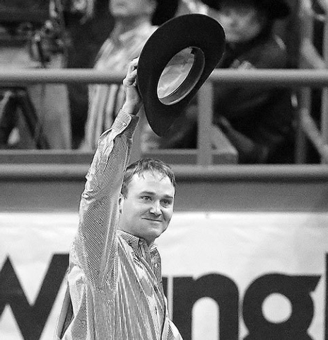 Casey Martin of Sulphur, La., tips his hat to the crowd after recording a time of 3.40 for first place in the steer wrestling go-round on Dec. 6, 2012, at the National Finals Rodeo. (AP Photo/Juli ...