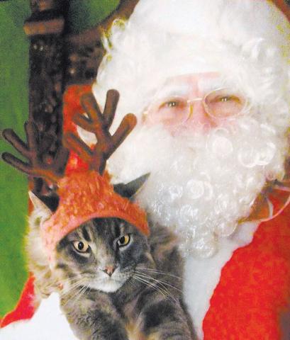 Cat Santa poses with Oscar, the columnist's cat, on Saturday at Bonanza Cat Hospital's Poppy Foundation fundraiser. (Courtesy)