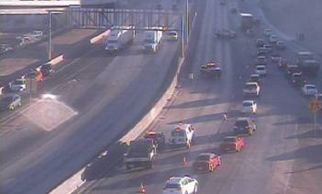 U.S. Highway 95 by the Spaghetti Bowl was backed up Tuesday morning after a vehicle rolled just before I-15. One man was transported to the hospital in serious condition. (Nevada Department of Tra ...