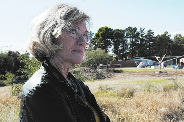 Laura Arnold, resident at the Elkhorn Ponderosa community in Las Vegas, is seen near the site where an AT&T cell tower is expected to be built , Tuesday, Oct. 29, 2013. Winslow has taken the lead  ...