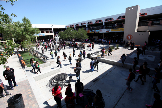 Chaparral High School students hurry between classes on the first day of school in Las Vegas on Aug. 29, 2011. Chaparral is one of the five high schools being cleaned in the wake of last week's  ...