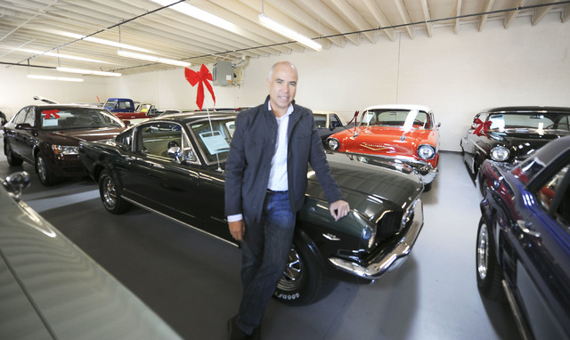 Mike Nicholl poses next to a 1965 Ford Mustang at Classic & Collectable Cars in Las Vegas, Friday, Dec. 13, 2013. Nicholl, the owner of the business, received an SBA loan to turn a burned-out bake ...