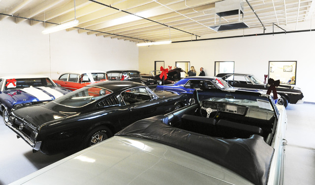 Some of the cars available at Classic & Collectable Cars in Las Vegas, are seen Friday, Dec. 13, 2013. Michael Nicholl, the owner of the business, received an SBA loan to turn a burned-out bakery  ...