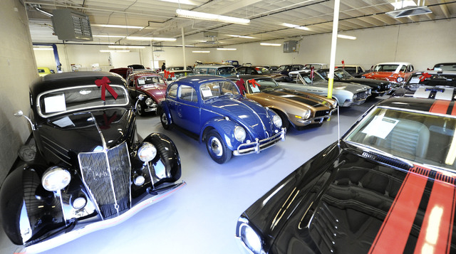 Some of the cars for sale are seen at Classic & Collectable Cars in Las Vegas, Friday, Dec. 13, 2013. Michael Nicholl, the owner of the business, received an SBA loan to turn a burned-out bakery i ...
