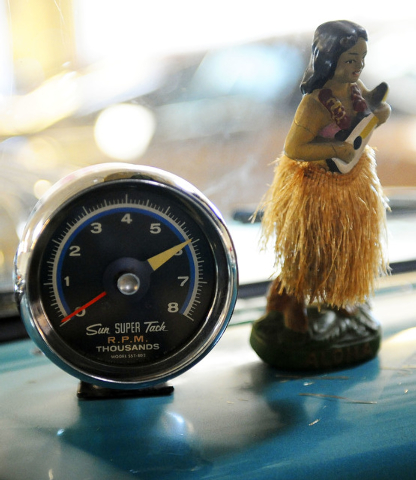 A tachometer and a hull girl are seen on the dash of a 1955 Chevrolet station wagon at Classic & Collectable Cars in Las Vegas, Friday, Dec. 13, 2013. Michael Nicholl, the owner of the business, r ...